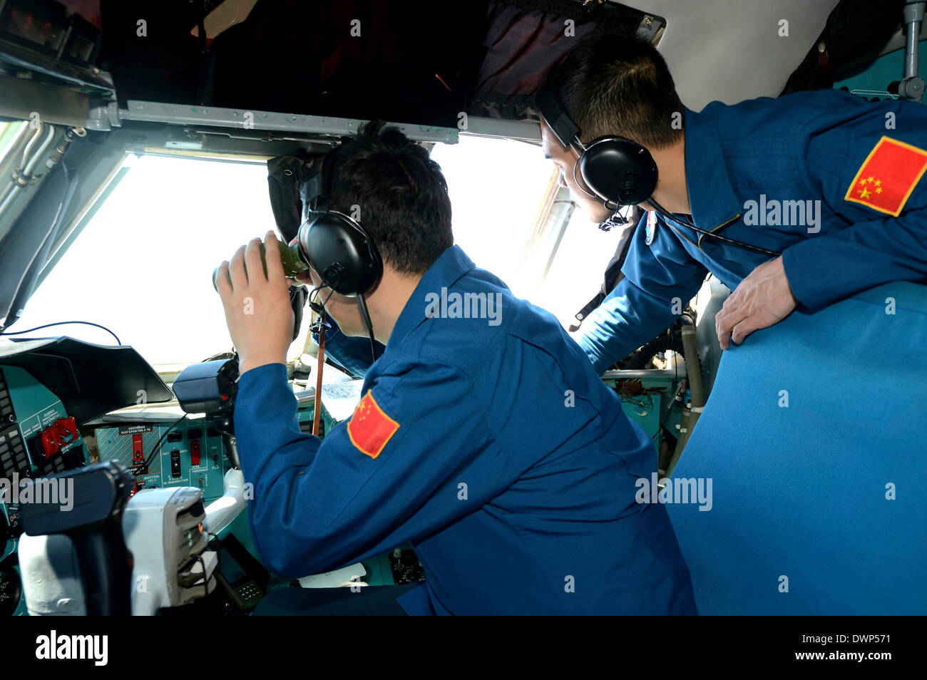 Malaysia, Malaysia. 12th Mar, 2014. Crew members of Chinese Air Force search the sea areas where the missing Malaysia Airlines flight MH370 lost contact, Malaysia, March 12, 2014. Multinational search operation to locate missing Malaysia Airlines flight MH370 has been expanded to two areas with more countries joining in the mission. Credit:  Shen Ling/Xinhua/Alamy Live News - Stock Image