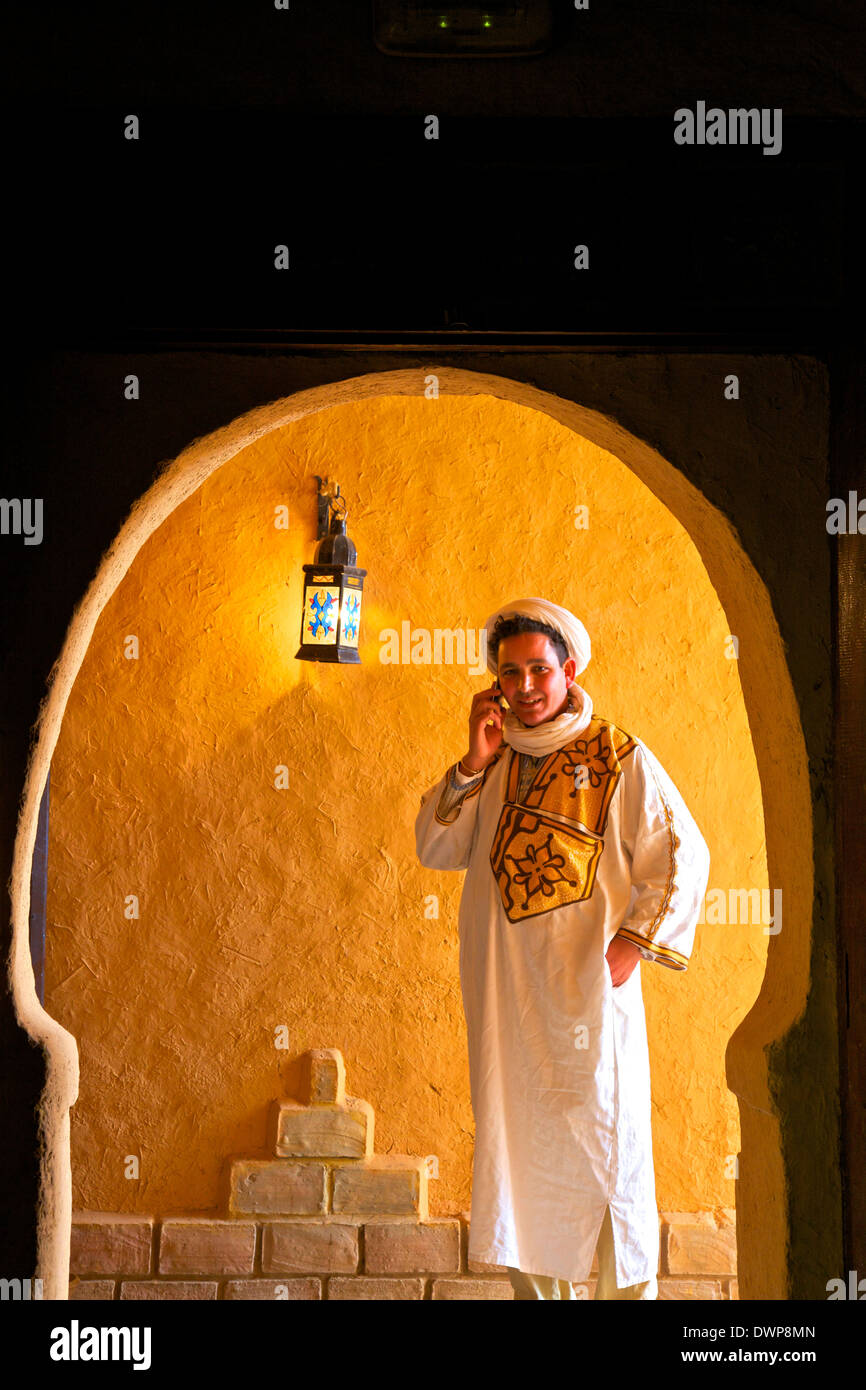 Berber Man In Berber Costume With Mobile Phone, Merzouga, Morocco, North Africa - Stock Image