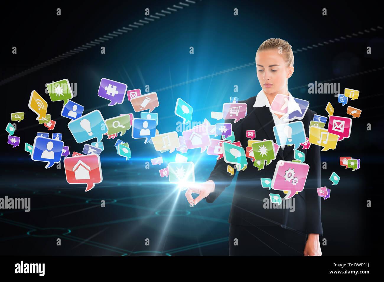 Blonde businesswoman touching app icon interface - Stock Image