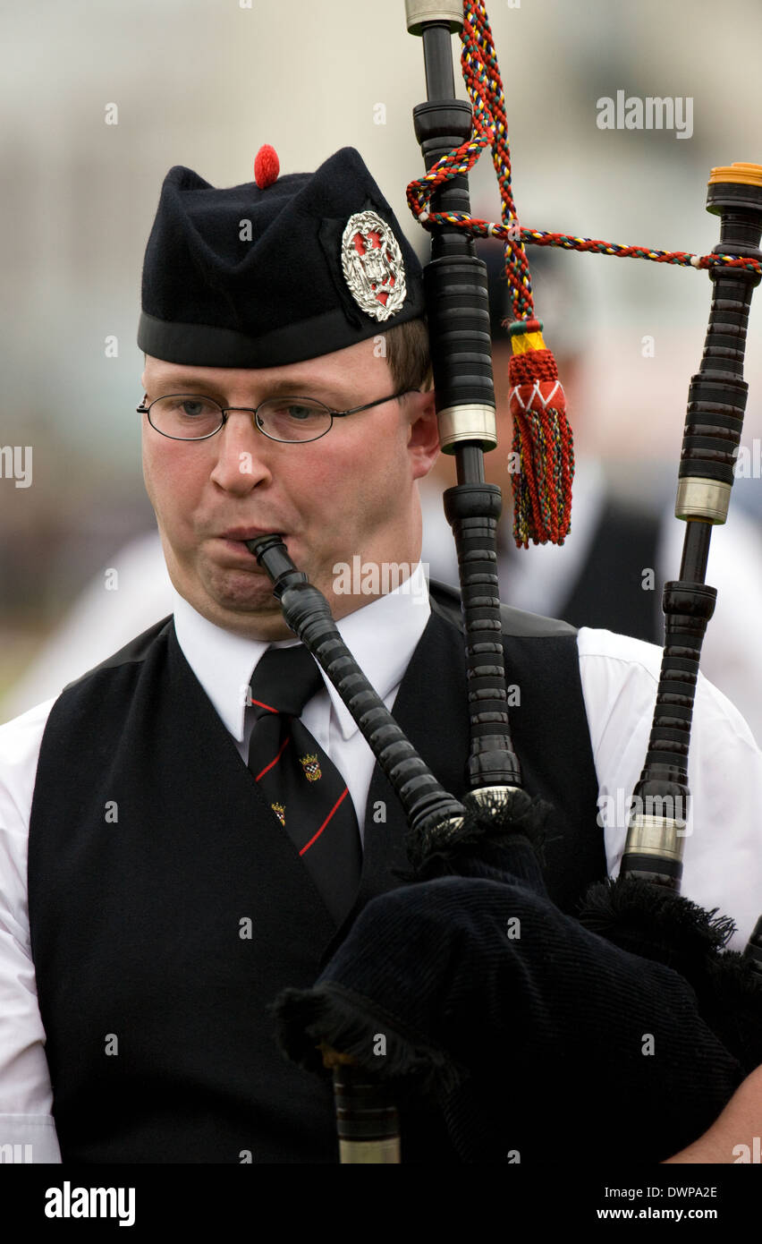 Piper in a pipe band at the Cowal Gathering in Dunoon in Scotland - Stock Image