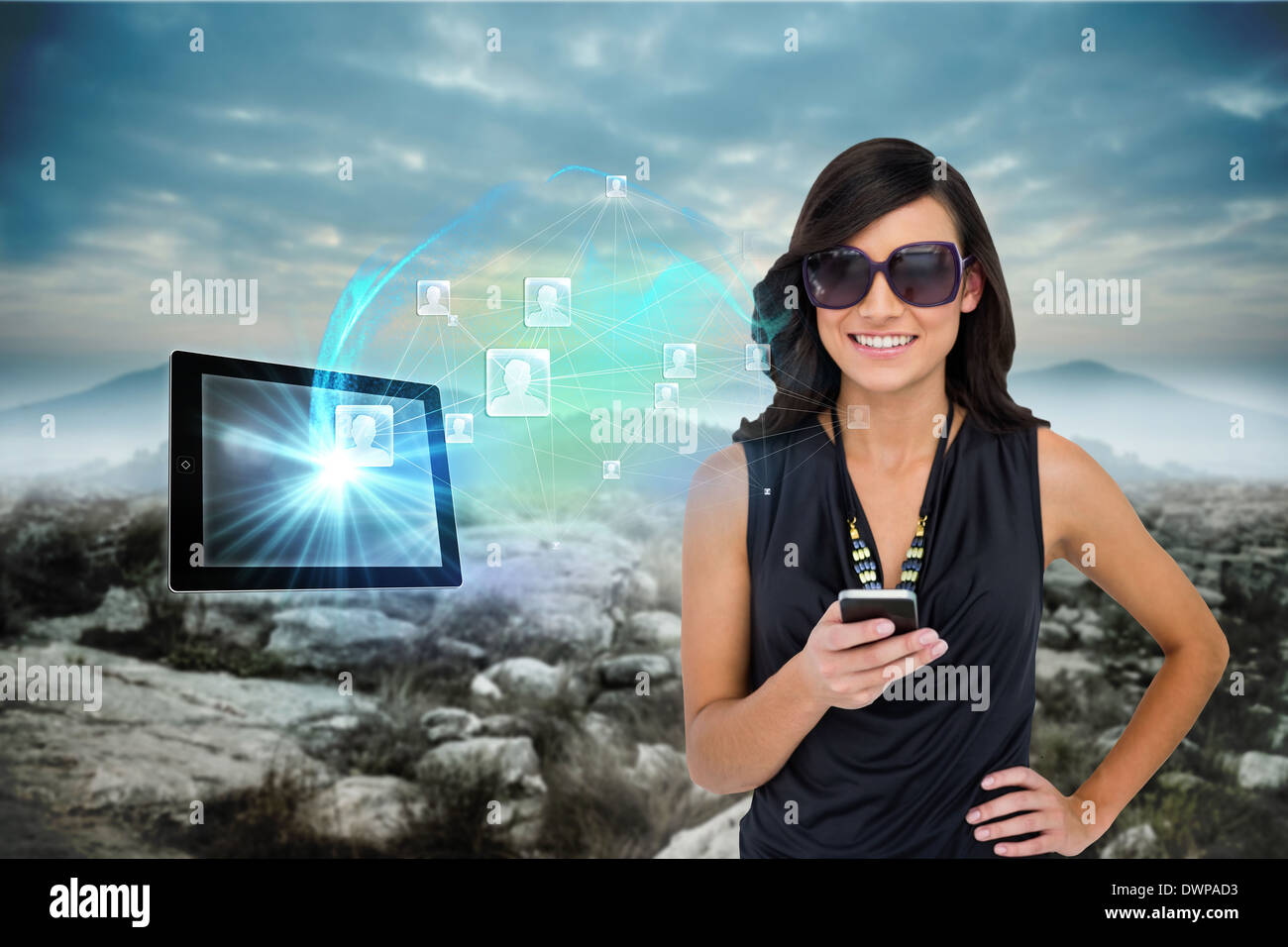 Glamorous brunette using smartphone with profile pictures - Stock Image