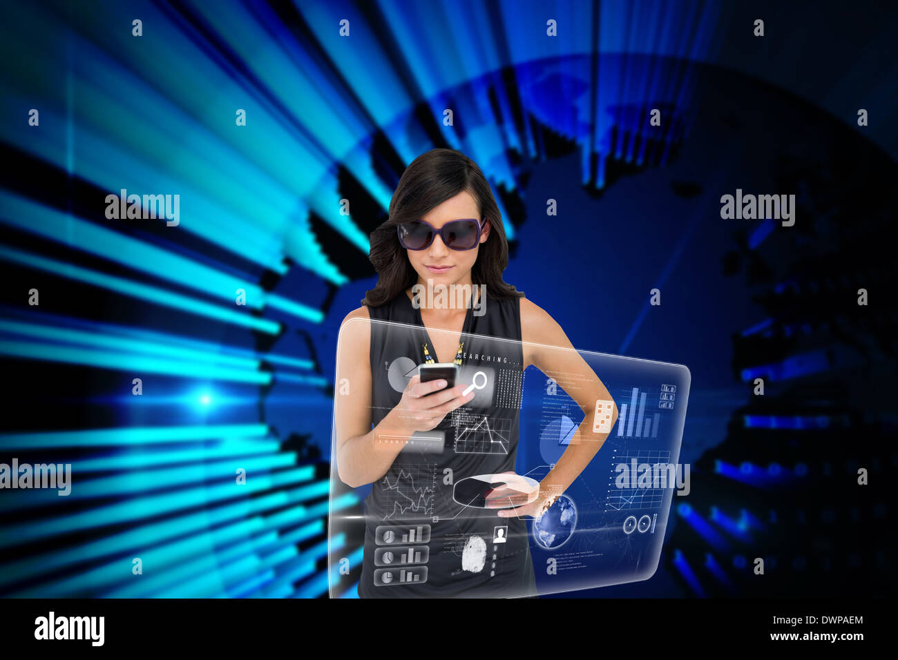 Glamorous brunette using smartphone with interface - Stock Image