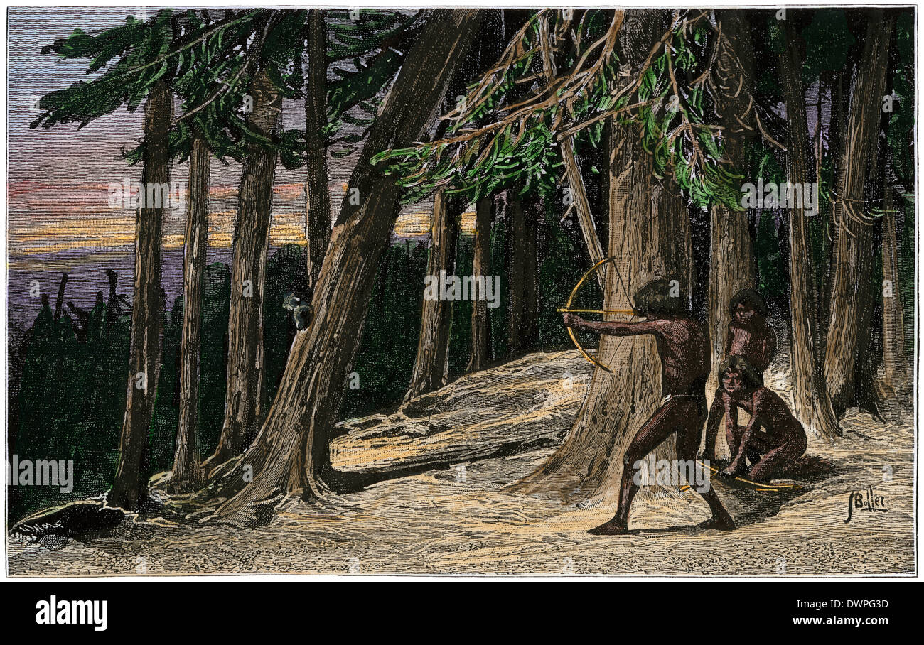 Native American boy practicing archery in a precolumbian forest. Hand-colored woodcut - Stock Image