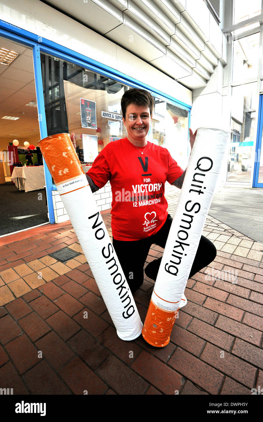 Peterlee, Co Durham, UK. 12th Mar, 2014. Anne  Pluse, an non smoking advisor from county durham spreads this year's No Smoking Day message that has a 'V for Victory' theme and is set to inspire hundreds of thousands of smokers to win the fight against cigarettes. The campaign will help smokers on the road to victory, providing information, support and encouragement to put together a personal battle plan so that they are in the best possible position to make a successful quit attempt on the day. Credit:  alan sill/Alamy Live News - Stock Image