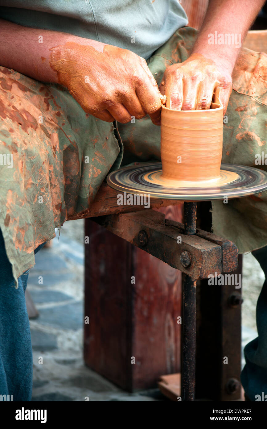 Potters Wheel, crafty hands creating mug Stock Photo