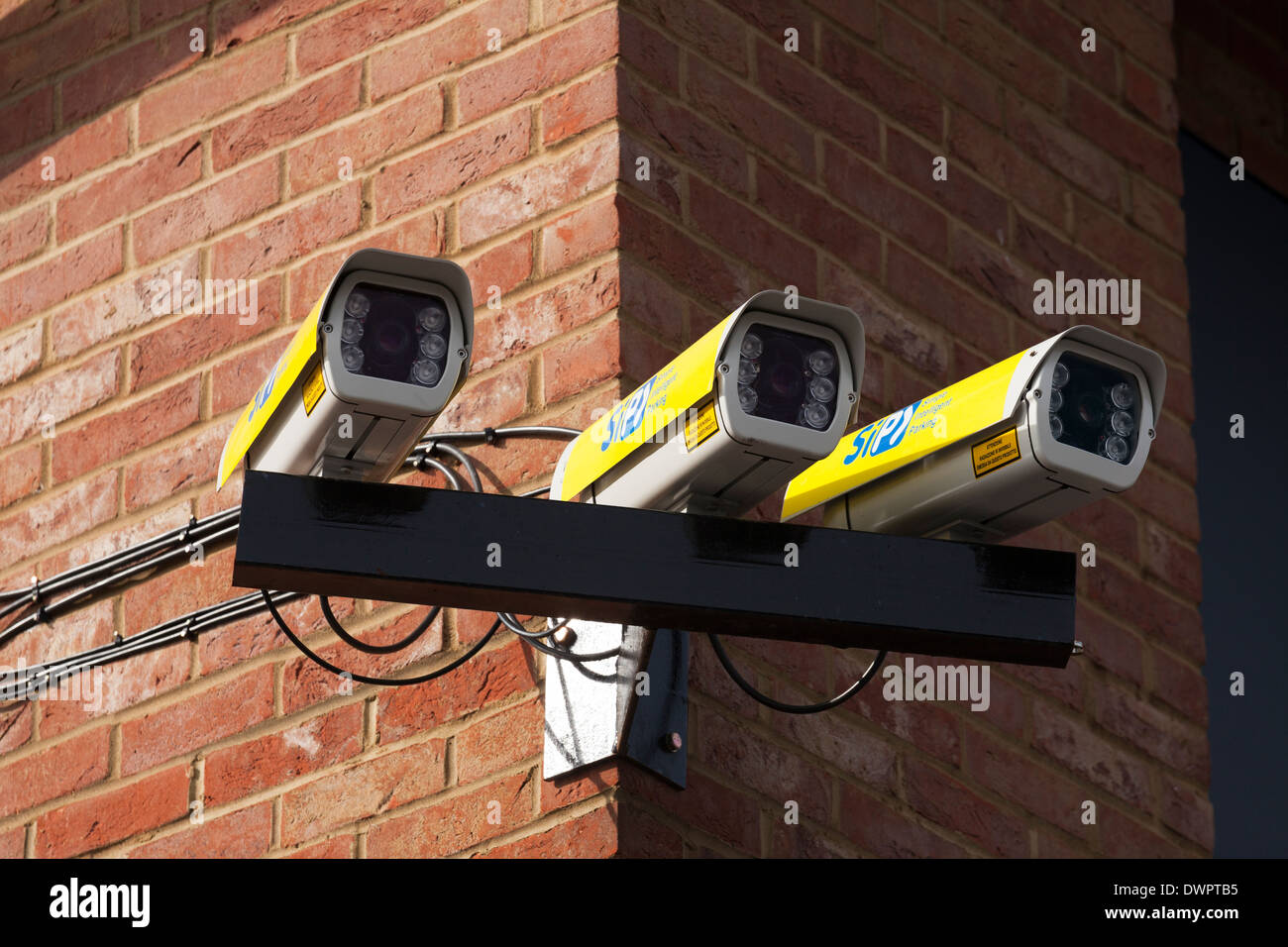 Three car park monitoring video cameras. - Stock Image