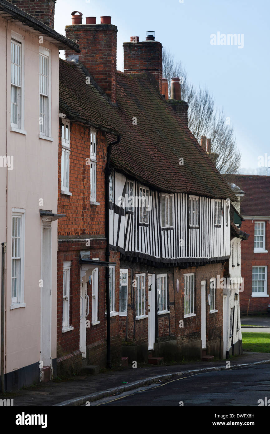 Old beamed terraced cottages in Sheep Street Petersfield. - Stock Image