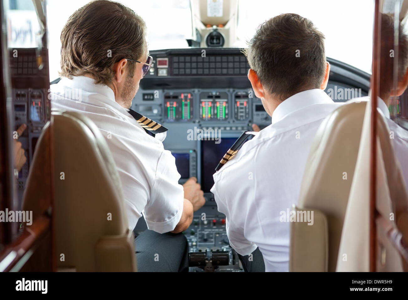 Pilot And Copilot In Private Jet Cockpit - Stock Image
