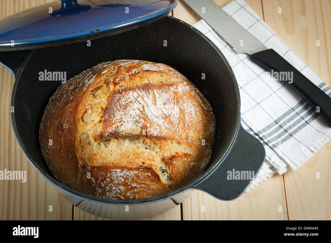 Home made bread baked in iron pot - Stock Image