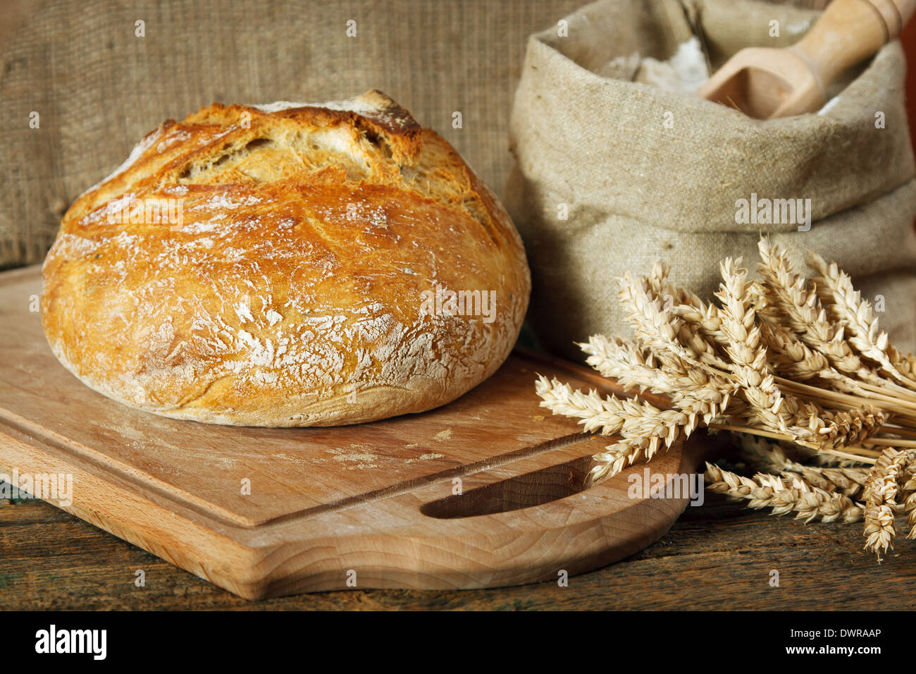 Bread loaf on wooden table - Stock Image