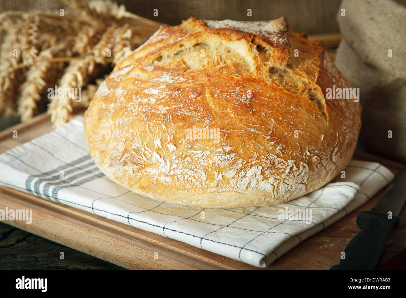 Home made bread on wooden table - Stock Image