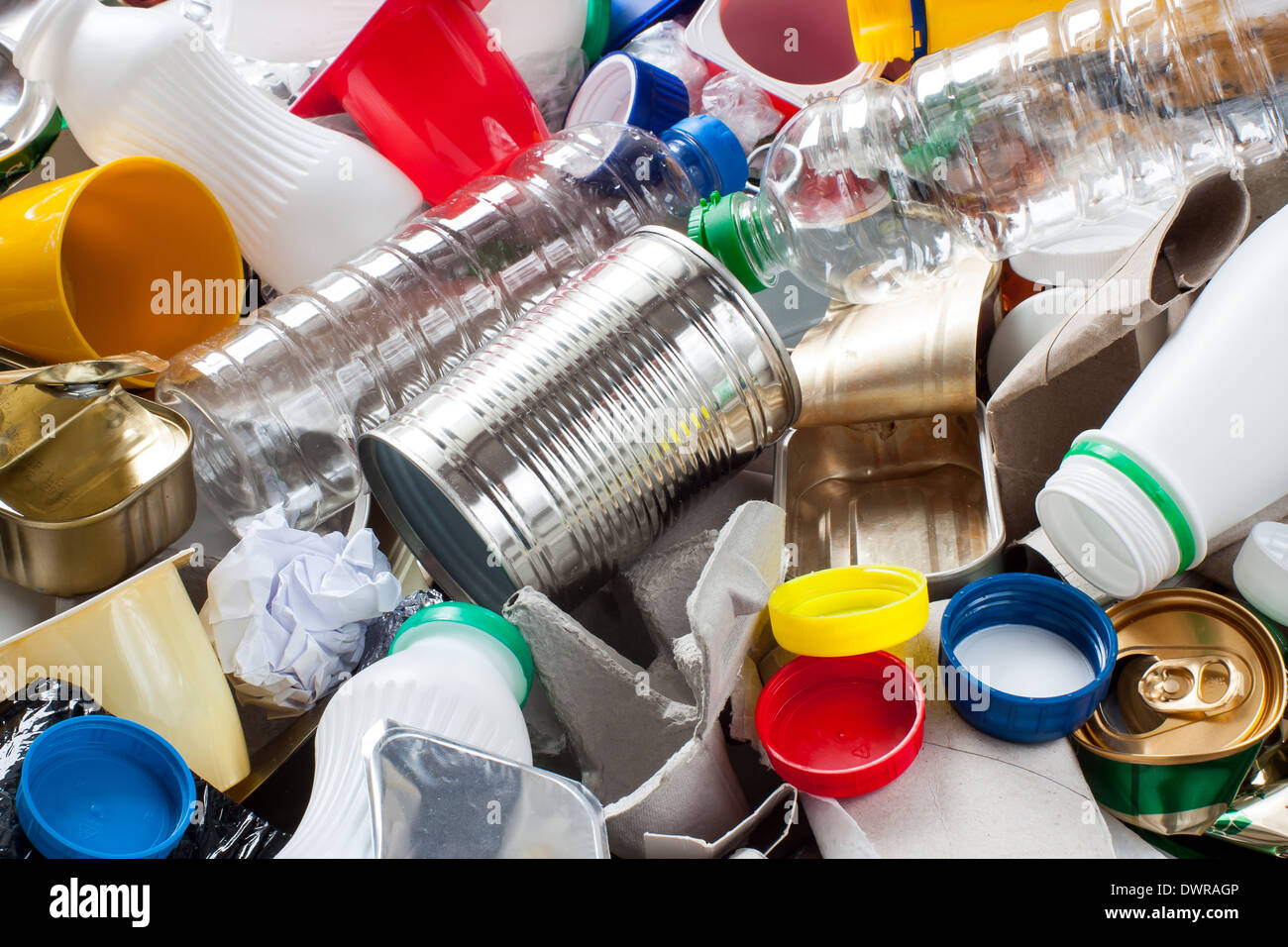 Reusable waste. Metal, plastic, paper and glass before segregation - Stock Image