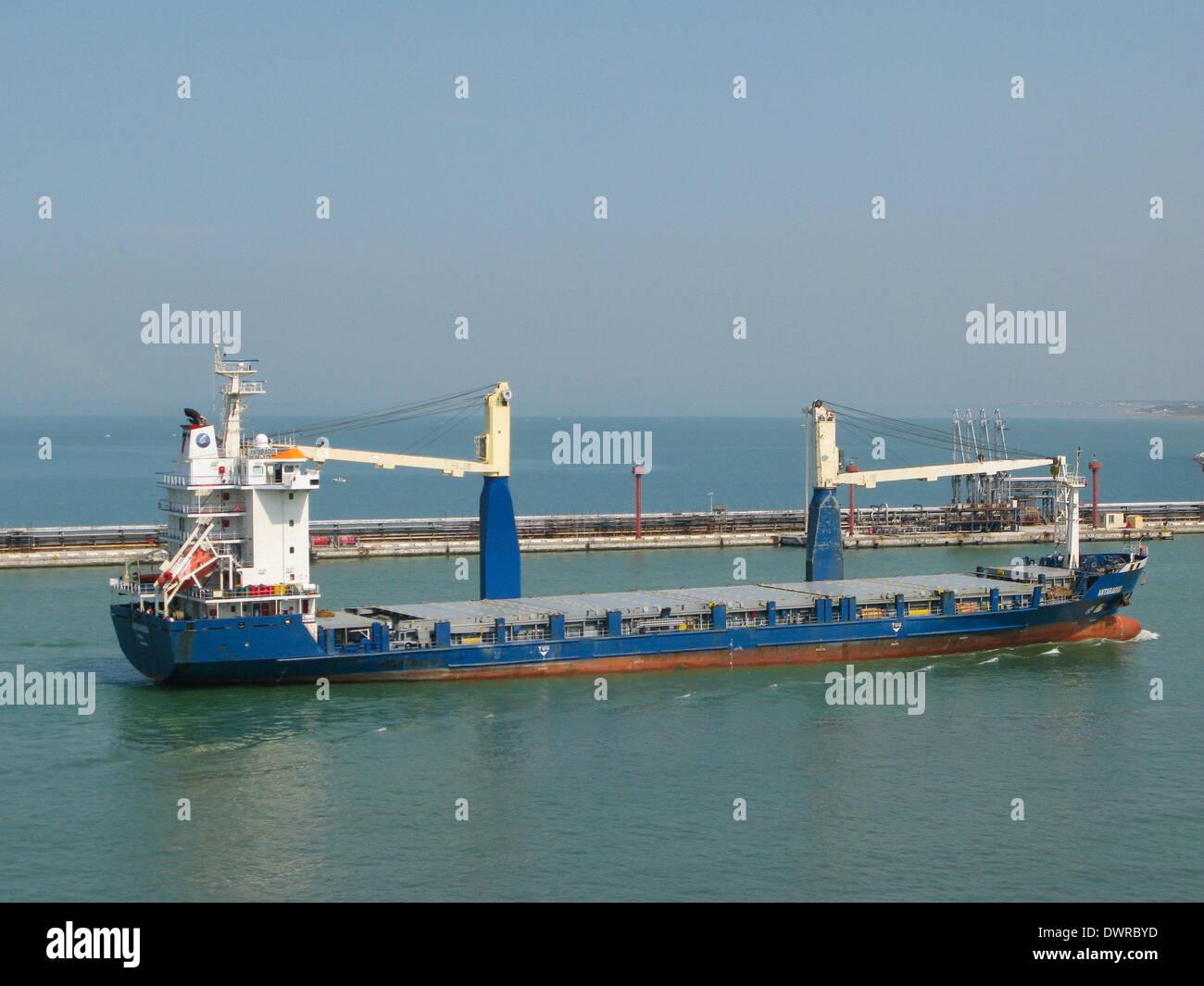 General cargo vessel mv Antaradus entering livorno harbor Italy - Stock Image
