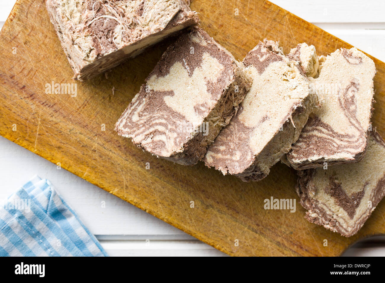pieces of tasty halva on kitchen table - Stock Image