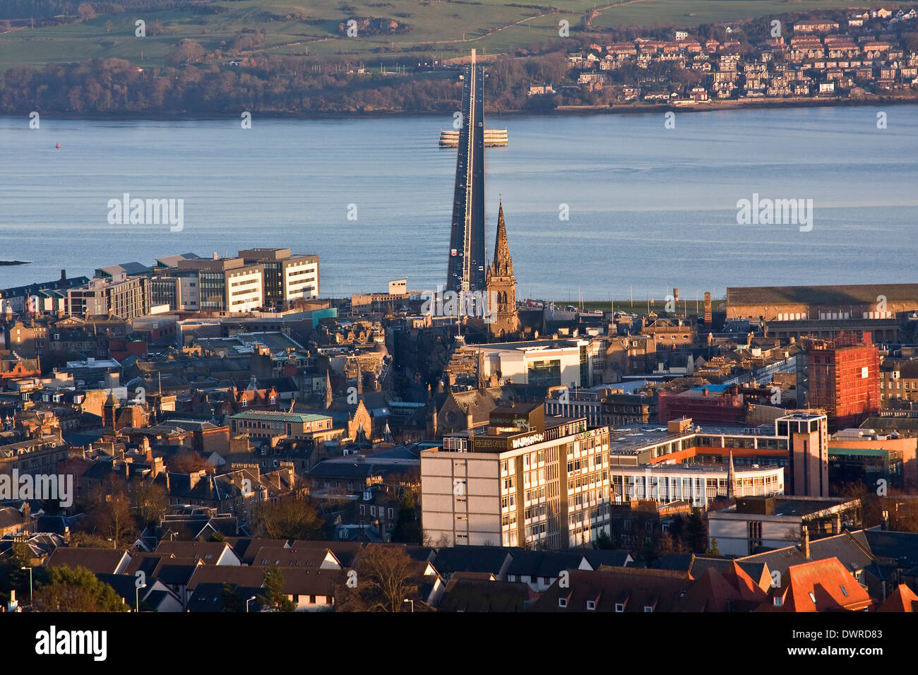 Landscape view of Dundee City and the Tay Road Bridge spanning across the River Tay from the Law at low sunlight, Stock Photo
