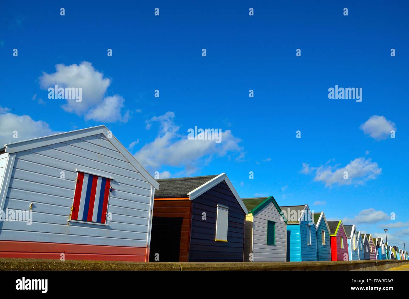 Row of beach huts near pier - Southwold, Suffolk. - Stock Image