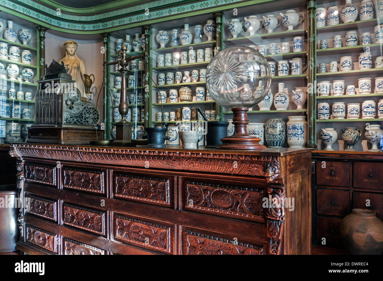 Medicines in Delft pottery of antique pharmacy / chemist's shop of the early 20th century, House of Alijn museum, Ghent, Belgium - Stock Image
