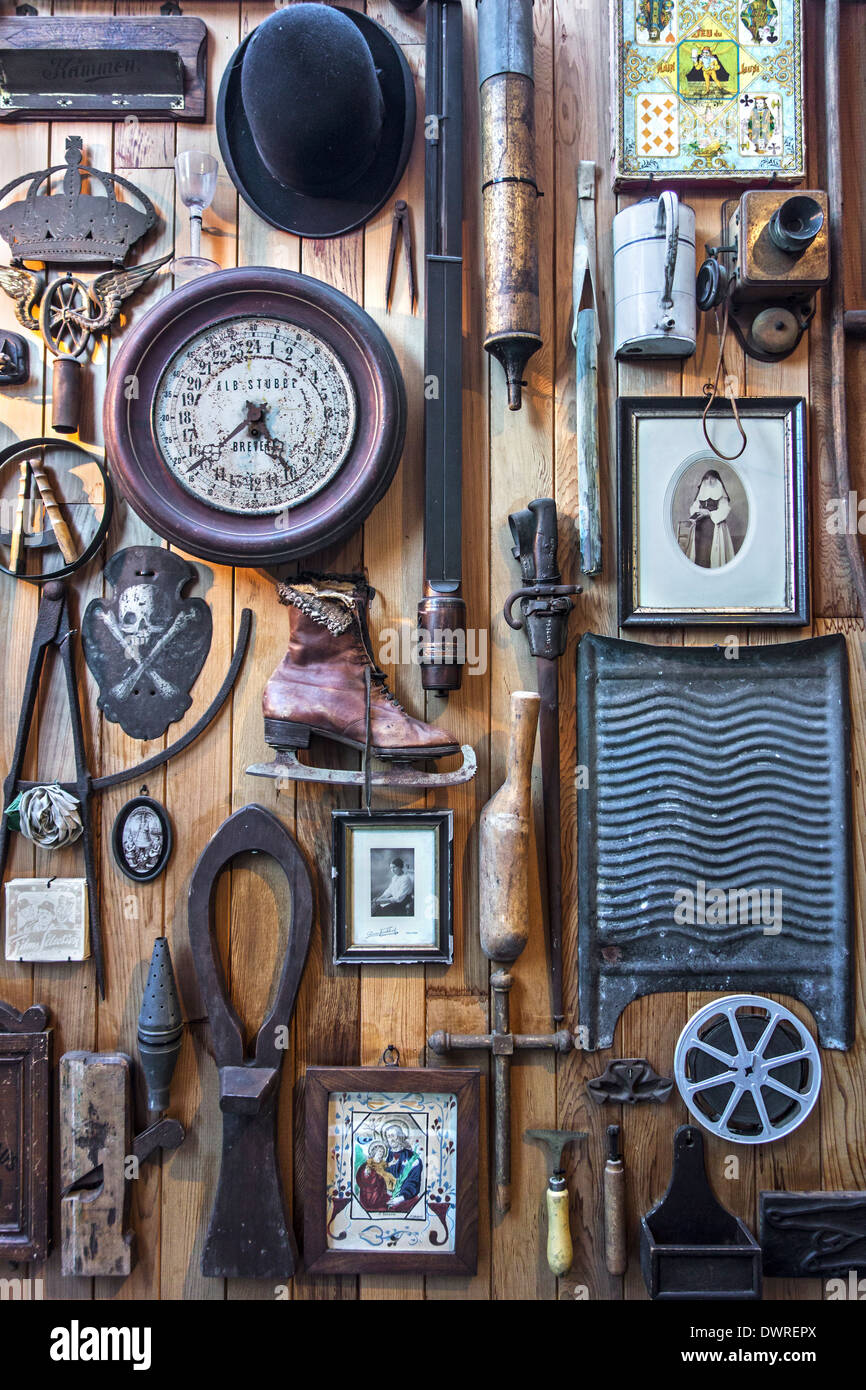 Various implements and utensils of the twentieth century at the House of Alijn museum, Ghent, Belgium - Stock Image