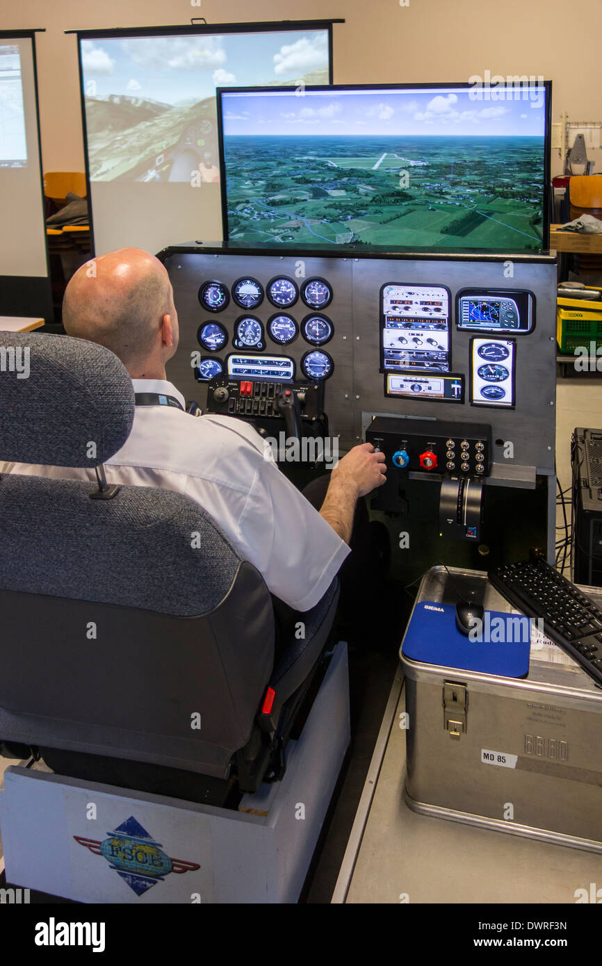 b80770cd983 Man navigating virtual airplane in amateur flight simulator - Stock Image