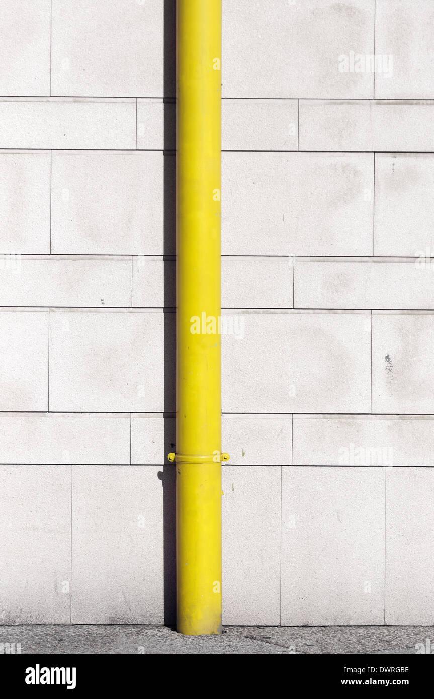 yellow drainpipe for the rain - Stock Image