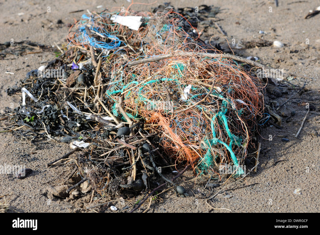 Discarded rubbish on a beach in Troon, Scotland - Stock Image