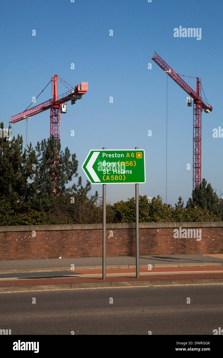Manchester, UK 12th March, 2014.   City construction boom.  Work has begun on the £55m building which will transform student life at the University of Salford when it opens in early 2016. The 'Gateway Project' will provide a distinctive, aesthetically pleasing entrance to the campus from Salford Crescent railway station. The building has been designed primarily for students of the School of Arts & Media. - Stock Image