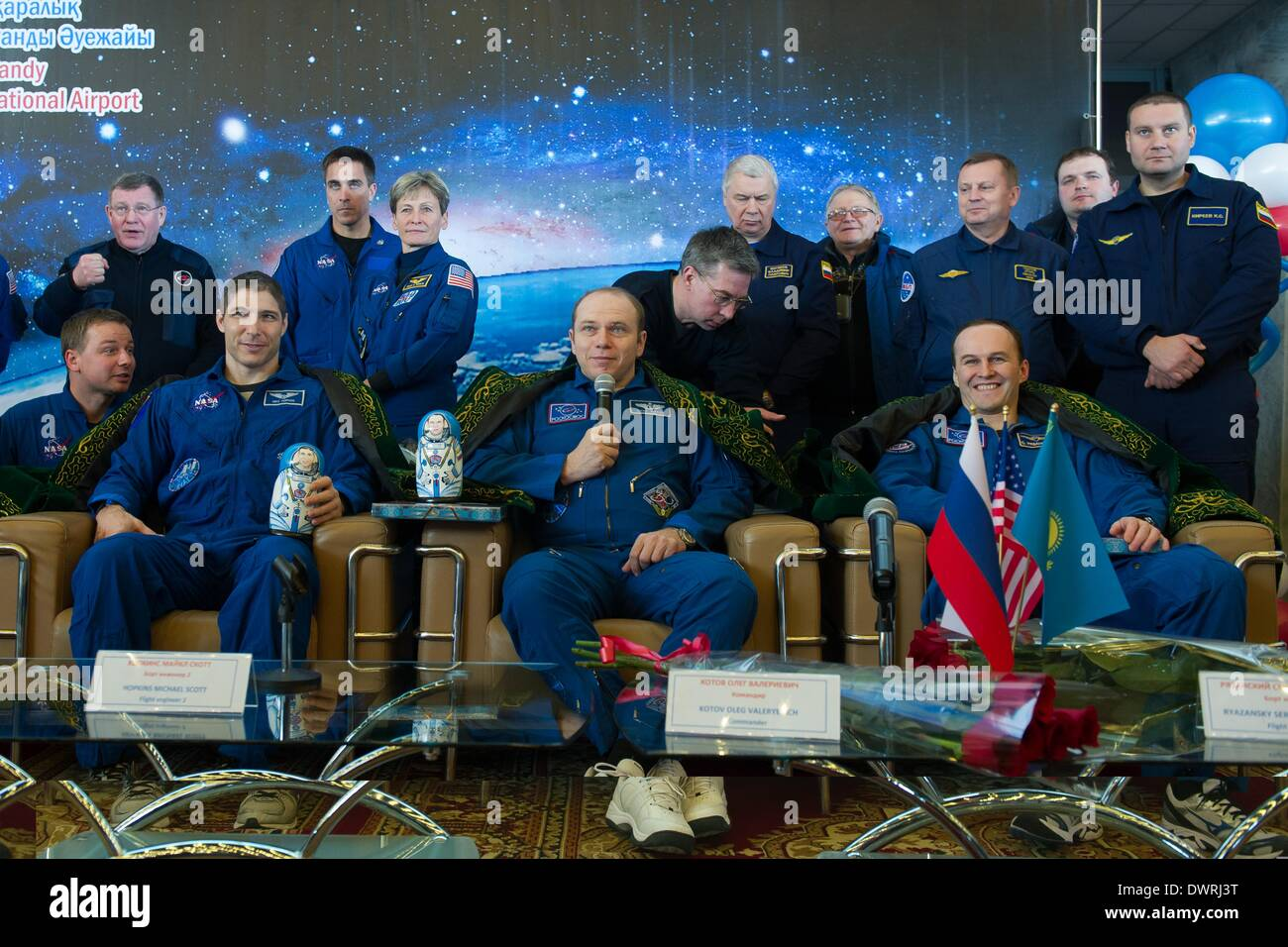 Karaganda airport, Kazakhstan. 11th March, 2014. International Space State Expedition 38 Mike Hopkins of NASA, left, Commander Oleg Kotov of the Russian Federal Space Agency, Roscosmos, center, and, Flight Engineer Sergey Ryazanskiy of Roscosmos during a welcoming ceremony after landing in a Soyuz TMA-10M spacecraft March 11, 2014 held at the Karaganda airport, Kazakhstan. Hopkins, Kotov and Ryazanskiy returned to Earth after five and a half months onboard the International Space Station. Credit:  Planetpix/Alamy Live News - Stock Image