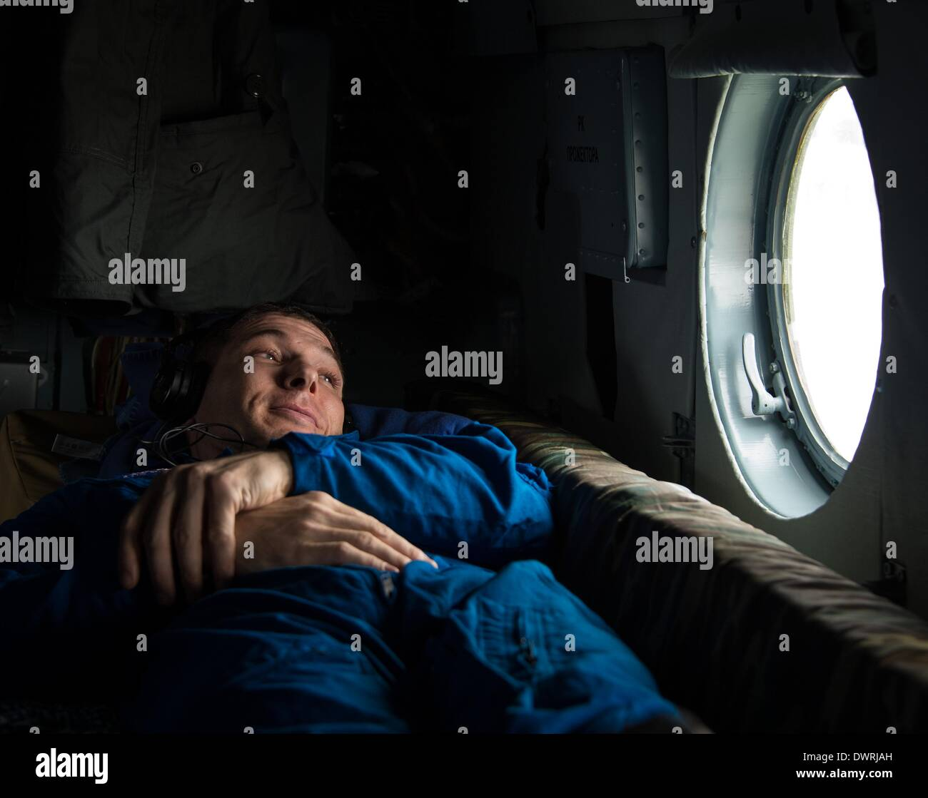 Karaganda airport, Kazakhstan. 11th March, 2014. International Space State Expedition 38 astronaut Mike Hopkins of NASA looks out the window of the Russian MI-8 helicopter after landing in a Soyuz TMA-10M spacecraft March 11, 2014 near the town of Zhezkazgan, Kazakhstan. Hopkins, Kotov and Ryazanskiy returned to Earth after five and a half months onboard the International Space Station. Credit:  Planetpix/Alamy Live News - Stock Image