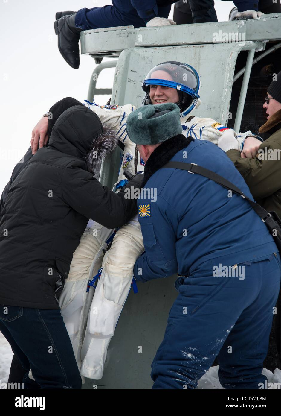 Karaganda airport, Kazakhstan. 11th March, 2014. International Space State Expedition 38 cosmonaut Sergey Ryazanskiy of the Russian Federal Space Agency is lifted out of the Soyuz Capsule after landing in a Soyuz TMA-10M spacecraft March 11, 2014 near the town of Zhezkazgan, Kazakhstan. Hopkins, Kotov and Ryazanskiy returned to Earth after five and a half months onboard the International Space Station. Credit:  Planetpix/Alamy Live News - Stock Image