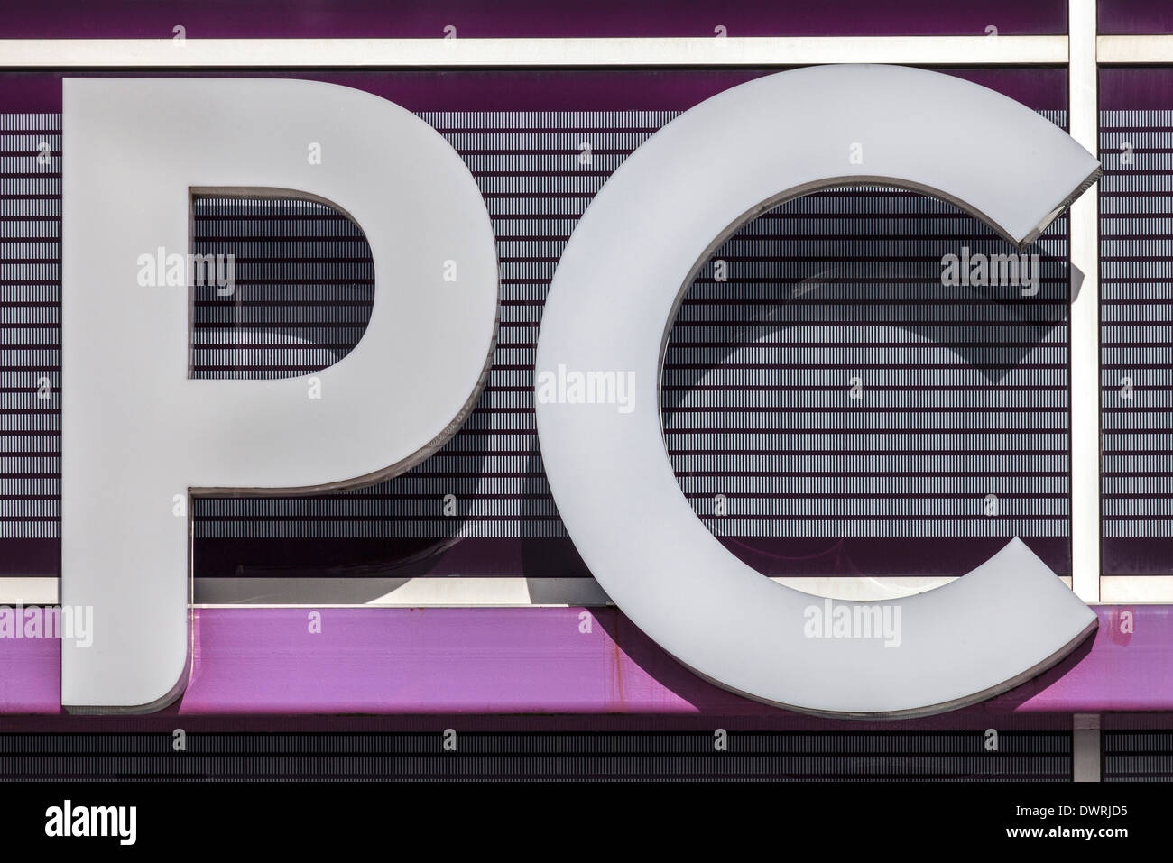 Shop sign with the letters PC - Stock Image