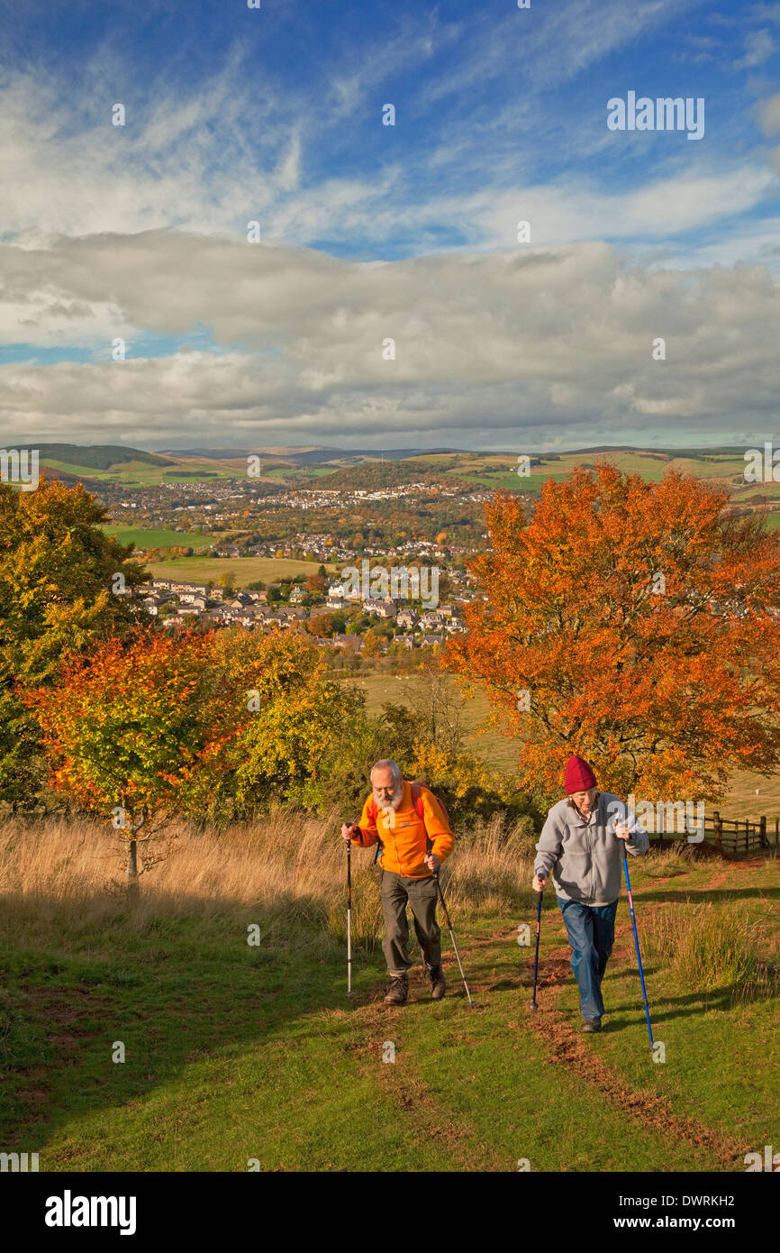 Walkers on St Cuthbert's Way in the Eildon Hills near Melrose - Stock Image