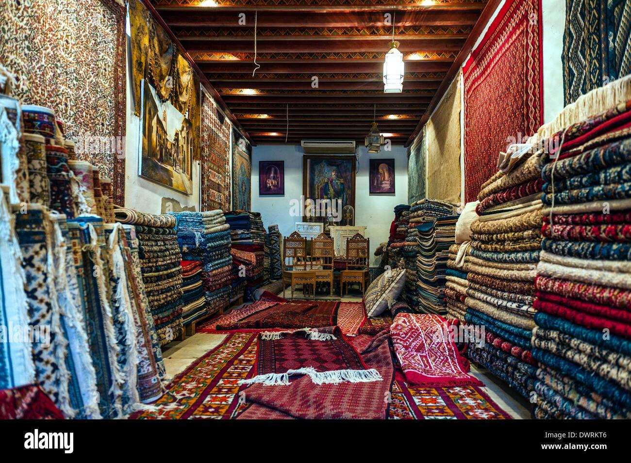 North Africa, Tunisia, Tunis. Carpets shop. - Stock Image