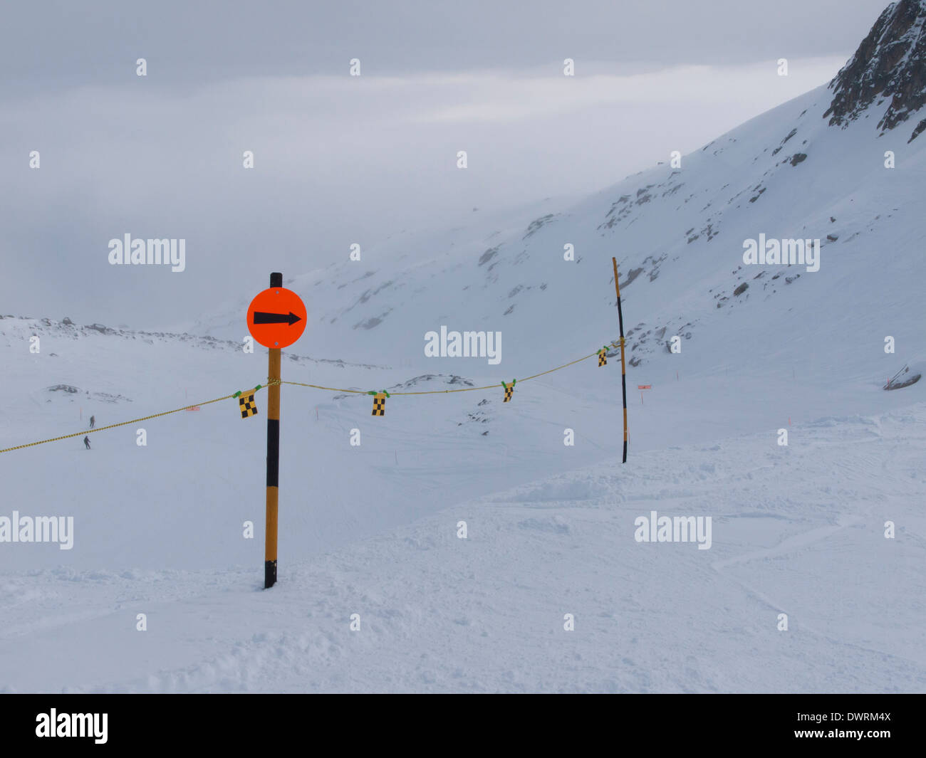 Directional Sign on an alpine ski slope in Distentis, Switzerland on Feb 21, 2013. - Stock Image