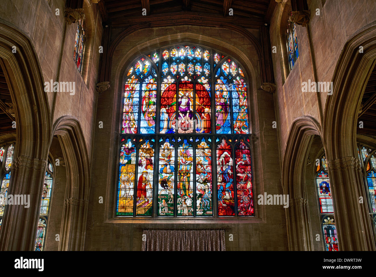 The Last Judgment window. Medieval stained glass window at Saint Marys church, Fairford, Gloucestershire, England. HDR - Stock Image