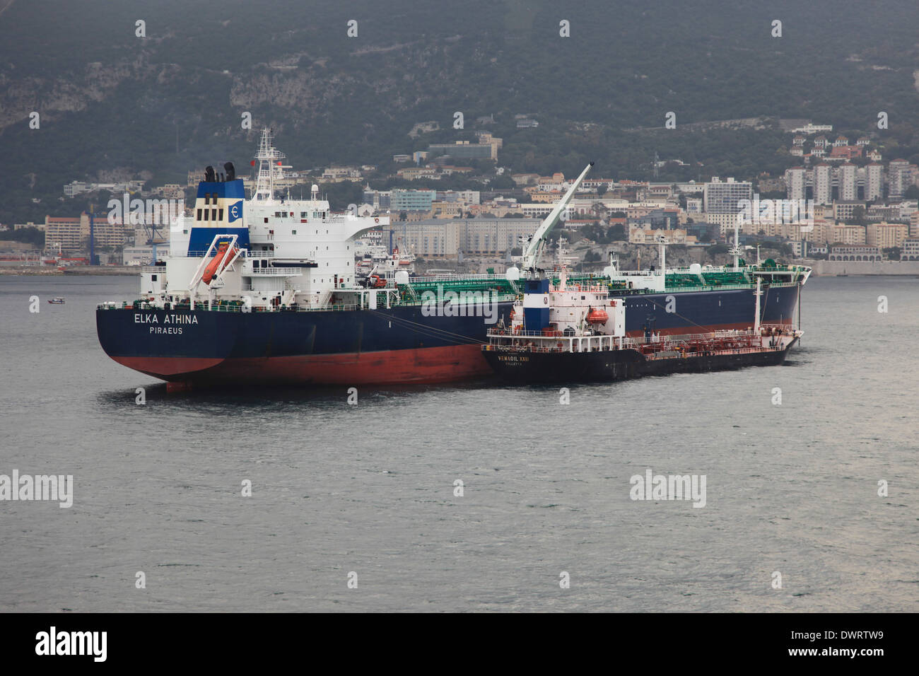 oil tanker mv Elka Athina anchored in Gibraltar harbor with bunkering tanker mv Vemaoil XXII alongside - Stock Image
