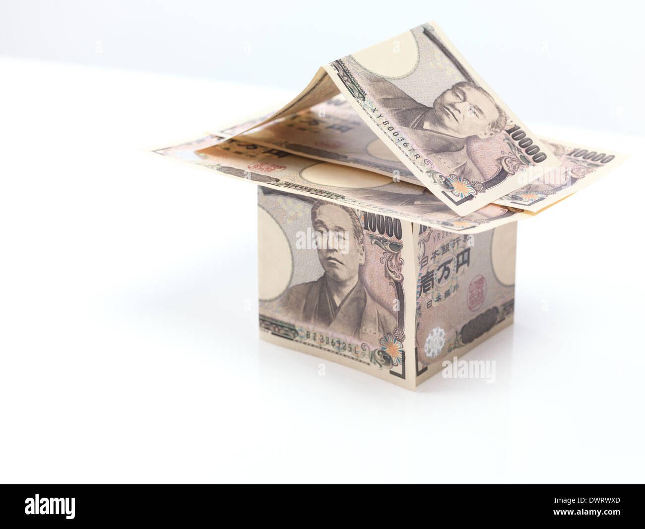 House made of Japanese Yen, money currency bills isolated on white background - Stock Image