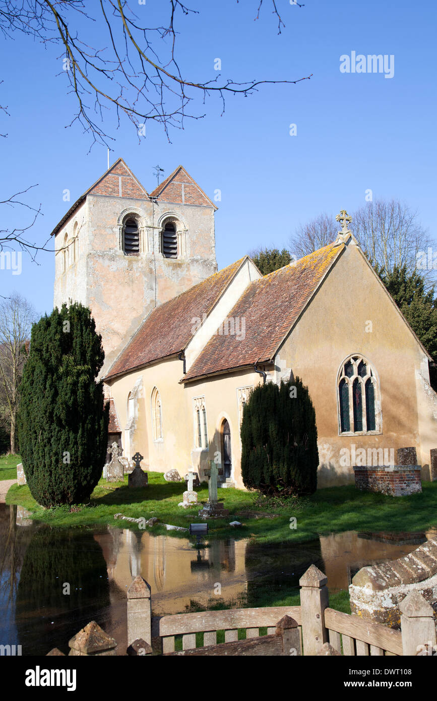 St Bartholomew Church in Fingest with flooded grounds in foreground - Buckinghamshire - UK - Stock Image
