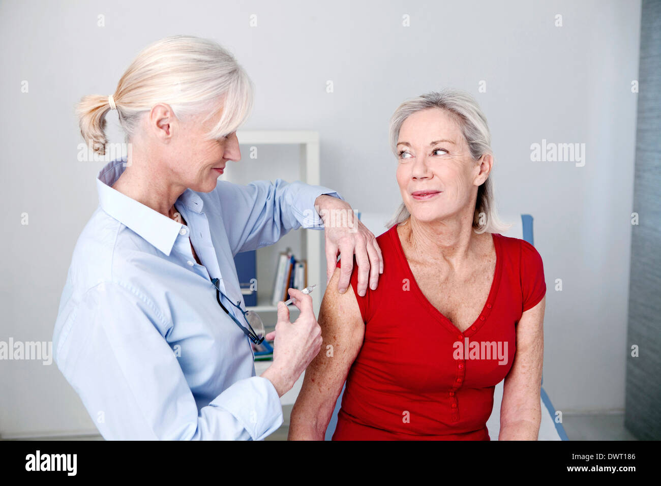 Vaccinating an elderly person Stock Photo