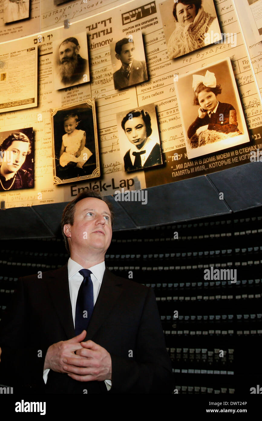 Jerusalem, Israel. 12th Mar, 2014. Visiting British Prime Minister David Cameron visits the Yad Vashem Holocaust Memorial museum in Jerusalem, on March 12, 2014. British Prime Minister David Cameron on Wednesday called on the Israeli Knesset (parliament) to reach out for historic peace with Palestinians, during his first visit to Israel as prime minister. British Prime Minister David Cameron is on a two-day visit to Israel and Palestinian territories. Credit:  POOL/Gali Tibbon/Xinhua/Alamy Live News Stock Photo