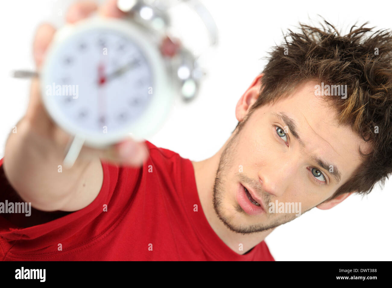 A frazzled man holding an alarm clock Stock Photo
