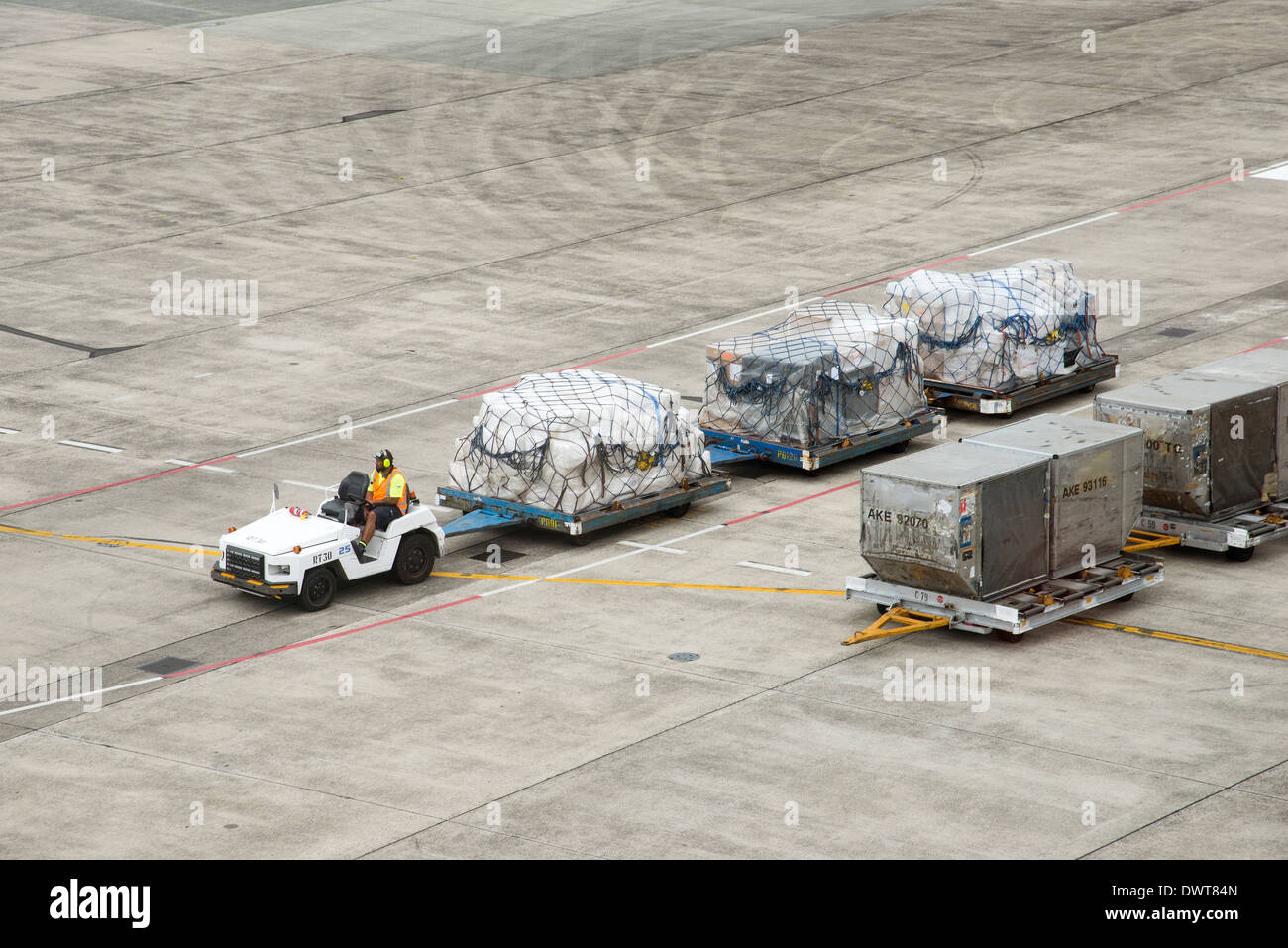 Airport cargo and freight handling truck at Auckland International Airport New Zealand - Stock Image