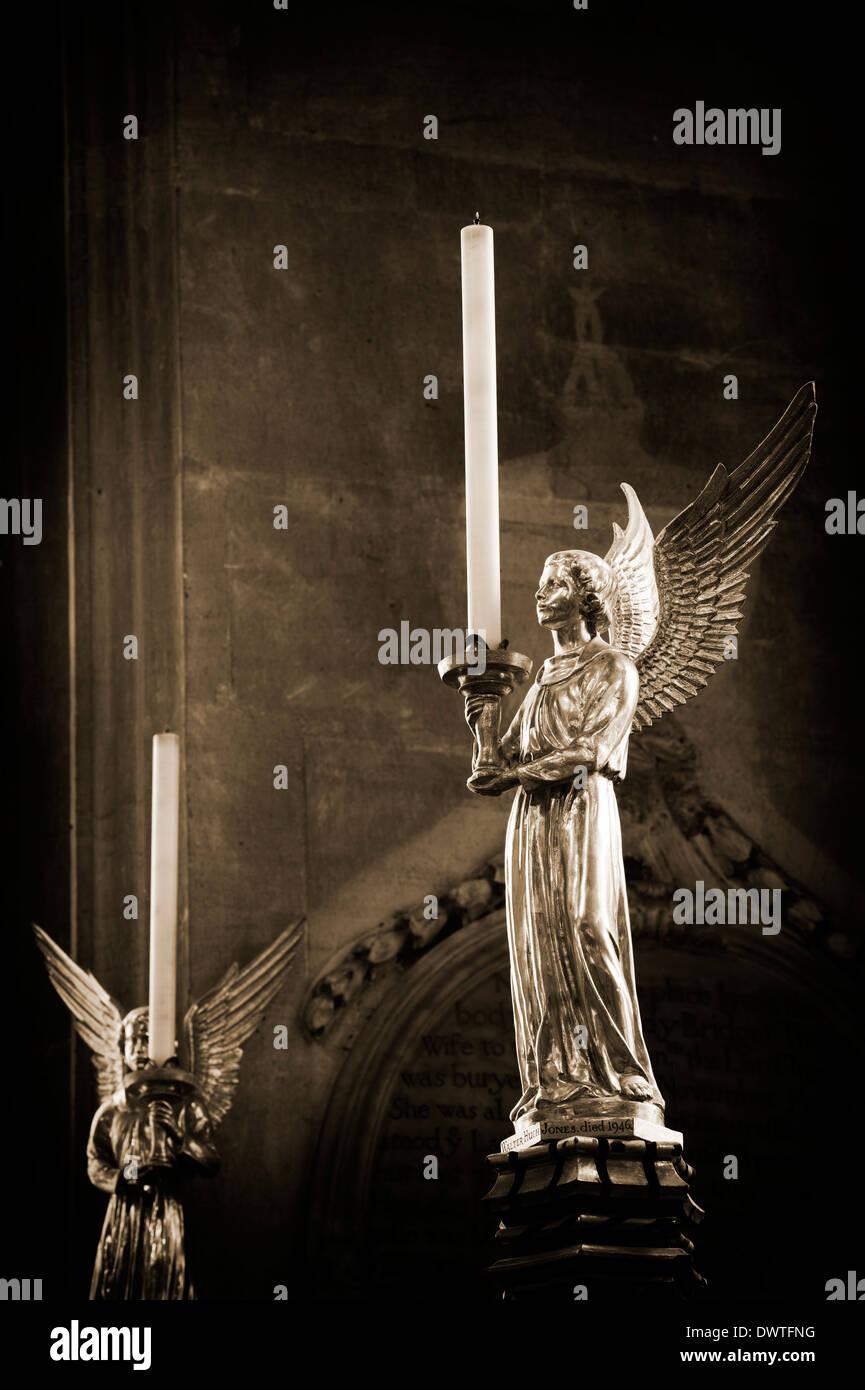 Angel candlesticks. Saint Marys church, Fairford, Gloucestershire, England. Sepia toned - Stock Image