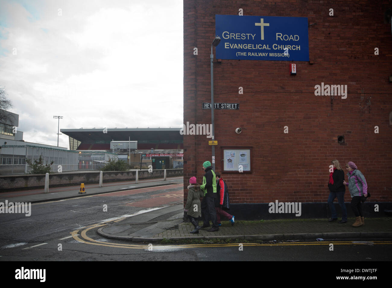 Home supporters walking into Gresty Road, Crewe, on their way the stadium of Crewe Alexandra FC. - Stock Image