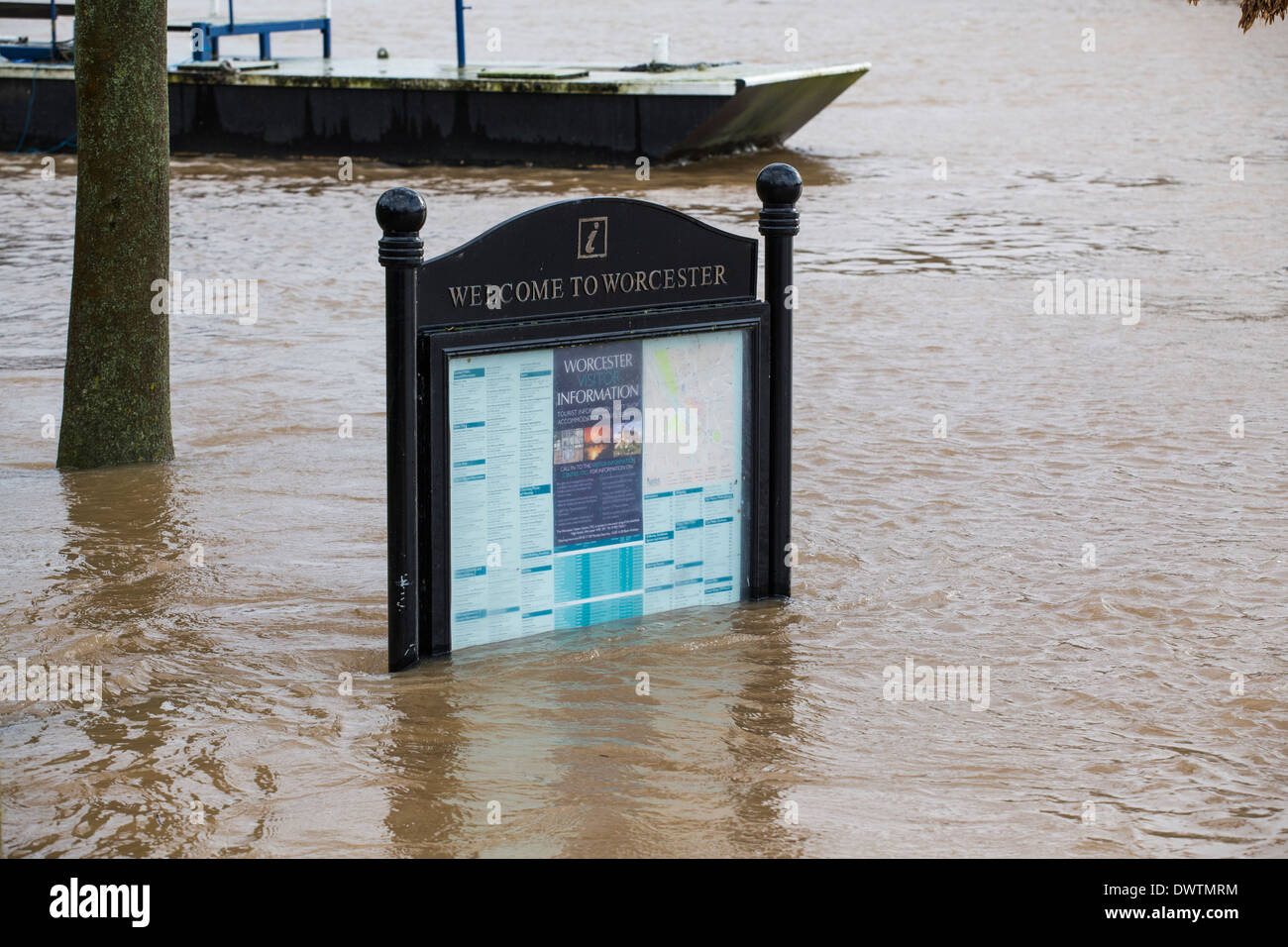 A tourist information sign in Worcester, UK, under water after the River Severn burst its banks - Stock Image