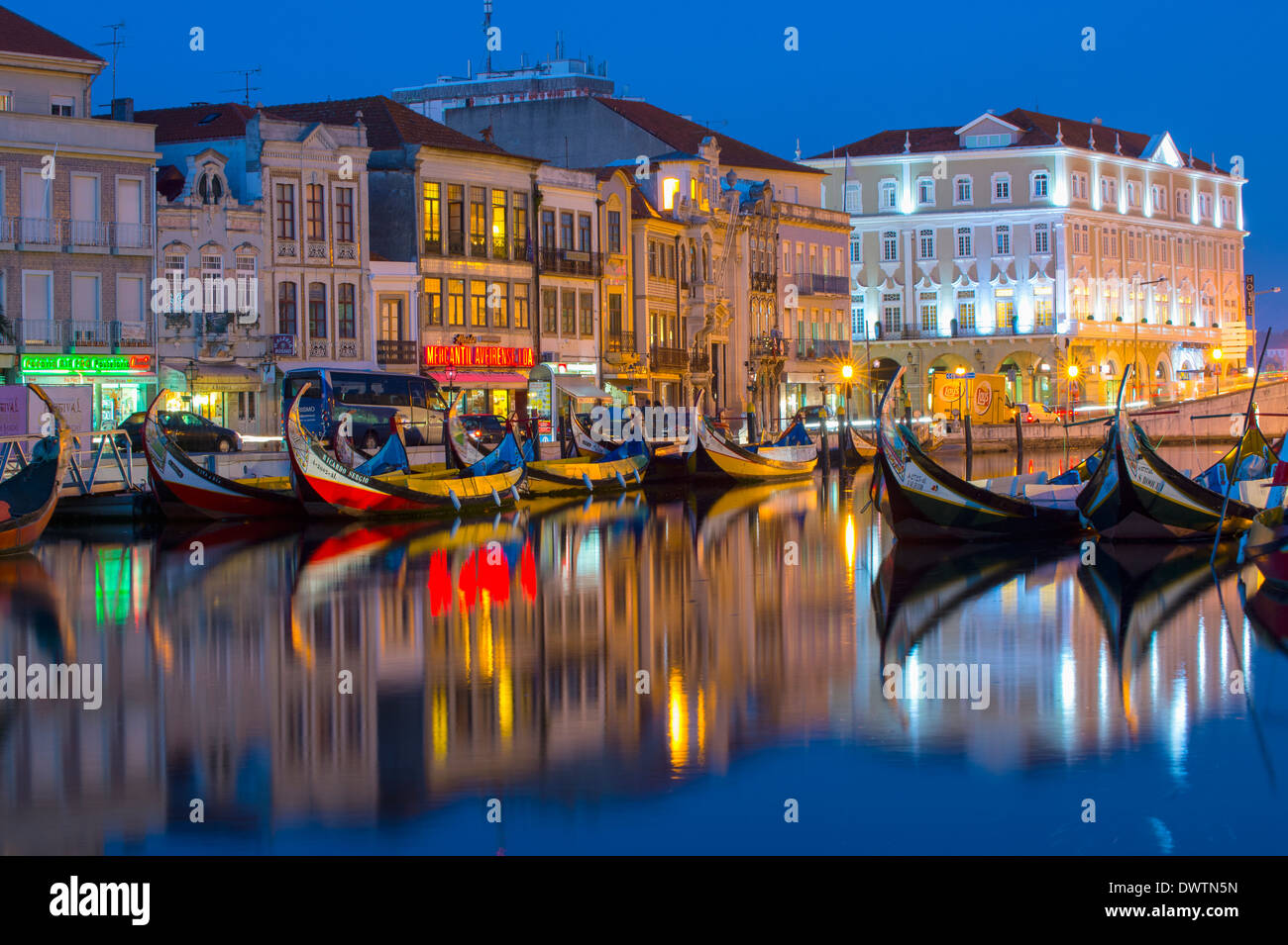 Gondola like Moliceiros boats anchored along the Central Channel at night, Aveiro, Beira, Portugal - Stock Image