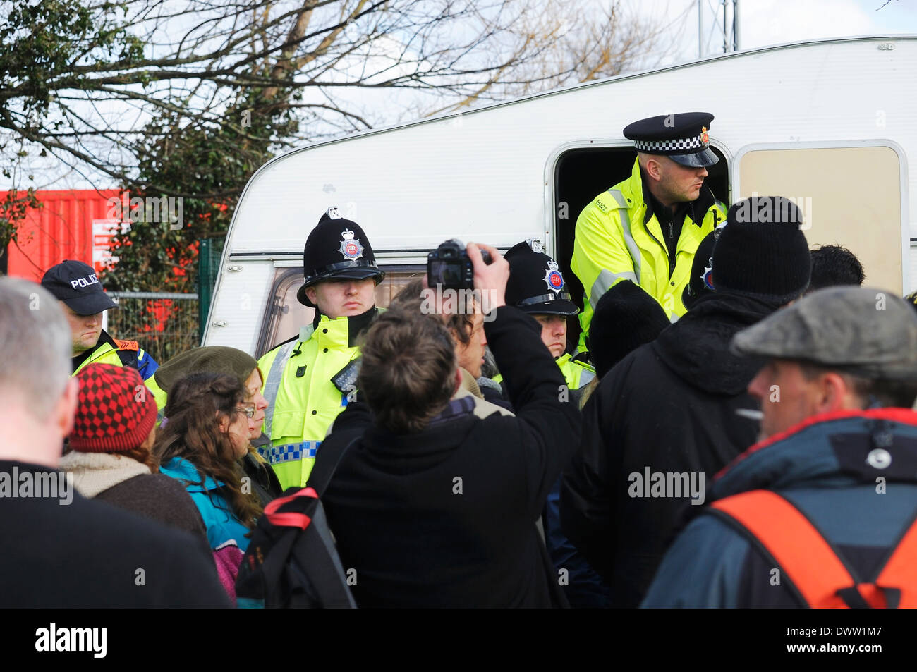 Police search an anti-frackers protesters caravan at Barton Moss Protection Camp without a search warrant. - Stock Image