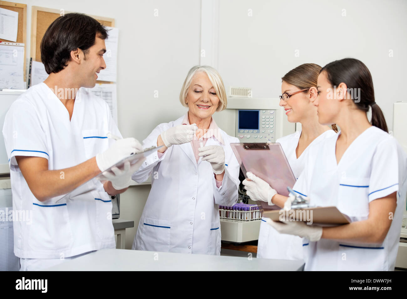 Scientists Discussing Over Sample In Laboratory Stock Photo