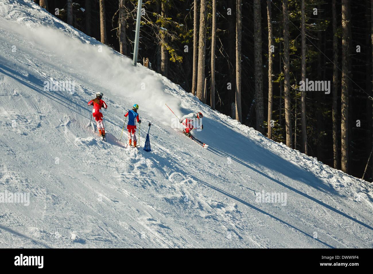Downhill skiers on piste of Todorka mountain, Bansko, Bulgaia - Stock Image