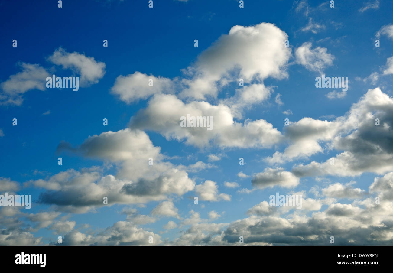 BLUE SKY WHITE CLOUDS - Stock Image