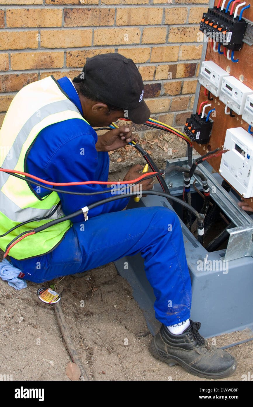 Christiaan Bailey is an electrician for the Overstrand municipality in and is installing upgrades to the Kleinmond residential - Stock Image
